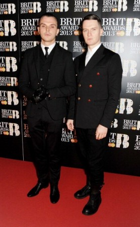 LONDON, ENGLAND - FEBRUARY 20:  (EMBARGOED FOR PUBLICATION IN UK TABLOID NEWSPAPERS UNTIL 48 HOURS AFTER CREATE DATE AND TIME. MANDATORY CREDIT PHOTO BY DAVE M. BENETT/GETTY IMAGES REQUIRED)  Theo Hutchcraft (L) and Adam Anderson of Hurts arrive at the BRIT Awards 2013 at the O2 Arena on February 20, 2013 in London, England.  (Photo by Dave M. Benett/Getty Images)