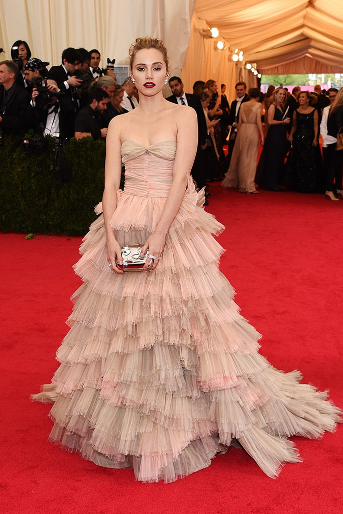 Suki Waterhouse attends 2014 Met Gala wearing Burberry with a Roger Vivier clutch. (Photography: Getty Images via Style.com) — with Suki Waterhouse at The Metropolitan Museum of Art, New York.
