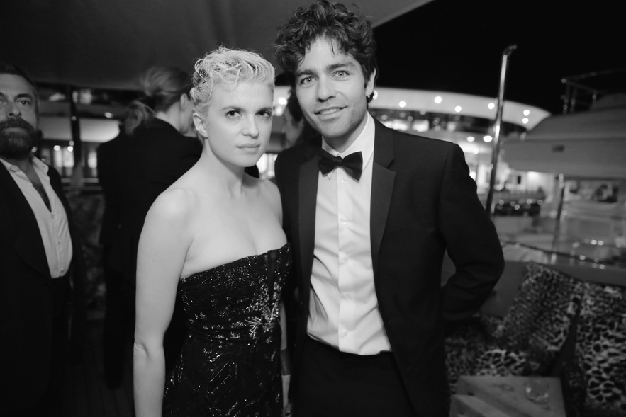 Cécile Cassel with Adrian Grenier at Cannes 2014 (Photography: Saskia Lawaks via vogue.fr)