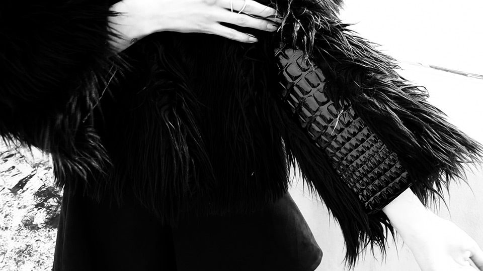Charlie Paille gives texture to a sleeve of this faux fur jacket using faux crocodile (Video still: Damien Neva)