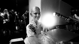 Ola Rudnicka grins during backstage beauty portraits | Prabal Gurung Spring 2015 (Video still: Damien Neva)