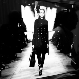 Odette Pavlova opens the show as pictured on the monitor backstage | Mulberry Autumn / Winter 2016 (Video still: Damien Neva)